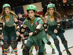 Violently stubborn: Ellen Page, center, with Drew Barrymore, left, and Kristen Wiig, plays a teen who joins the derby to rebel against her mom.