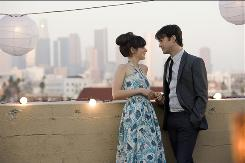 Summer (Zooey Deschanel) and Tom (Joseph Gordon-Levitt) are smitten with each other in (500) Days of Summer, which opens Friday. He writes greeting cards; she doesn't believe in true love.
