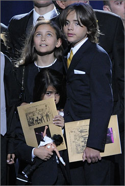 Paris Jackson, left, Prince Michael Jackson I and Prince Michael Jackson II join fans at the Los Angeles public memorial on July 7.