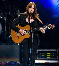 French First Lady Carla Bruni-Sarkozy performs at the 'Mandela Day' Concert at Radio City Music Hall in New York on Saturday.