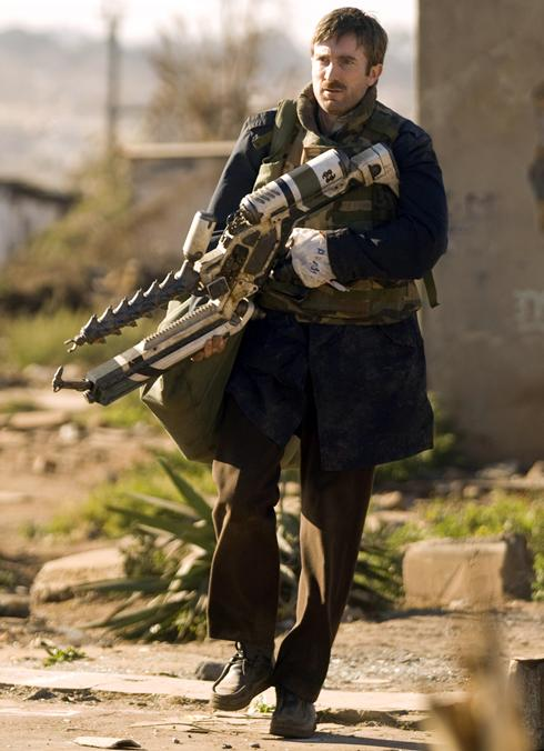 Sharlto Copley as Wikus in District 9