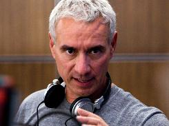 The director's life has been one disaster after another. But 2012's Roland Emmerich says he's moving on to Anonymous, a Shakespeare mystery, for his next movie.