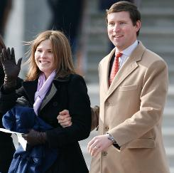 After Obama's inauguration: Jenna Bush Hager and her husband, Henry Hager, leave the Capitol.