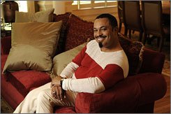 E. Lynn Harris during a photo session at his Atlanta home in 2008.