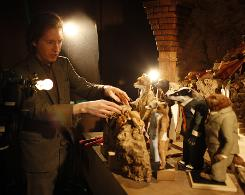 """It was the first book I ever owned"": Director Wes Anderson examines some of the puppets used in Mr. Fox."