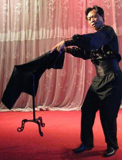Magician Wang Xianbo, 46, performs traditional routines in Zhaozhuang. Magicians young and old are practicing the art, finding audiences, and making money appear.