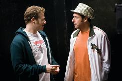 Ira (Seth Rogen), left, is a struggling stand-up comic and deli worker who is hired by George (Adam Sandler) to write jokes.