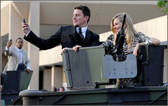 Channing Tatum and Sienna Miller arrive in style for the premiere of G.I. Joe at Andrews Air Force Base.