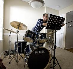 "Ray Soto practices his drumming using sheet music. He had been listening to songs via iTunes, and practicing along. But going digital-free meant going the paper route, and that was ""pretty cool,"" says Soto, who went five days without his tech connect."