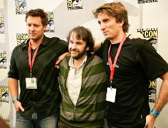District 9 producer Jackson, center, director Neill Blomkamp, left, and star Sharlto Copley gather to discuss their new movie at last's month's Comic-Con.