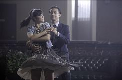 Zooey Deschanel's bank teller and Joseph Gordon-Levitt's bank robber do a dreamy dance number in the highly stylized music video that sprang from their collaboration in (500) Days of Summer. Gordon-Levitt has a solo dance number in the film, which opens wide Friday.