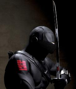 Ray Park stars as Snake Eyes in G.I. Joe. Park had the worst of the costume padding: He is covered head-to-toe in an extra-thick layer of rubber. His face is covered, and a wide black visor rests over his eyes. Plus, he wears the armor and winter garb that the other characters wear.