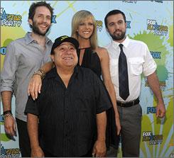 Glenn Howerton, left, Danny DeVito, Kaitlin Olson and Rob McElhenney star in It's Always Sunny in Philadelphia .