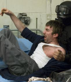 Sharlto Copley's character attracts unwanted attention after he contracts an alien virus that changes his DNA.