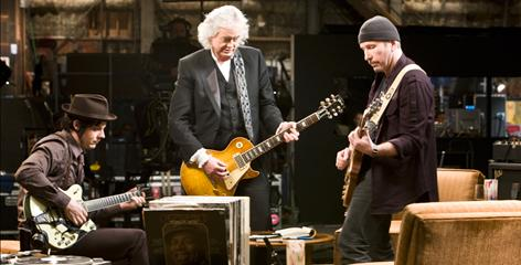 Eighteen strings playing as one: Jack White, left, Jimmy Page and The Edge make music in It Might Get Loud.