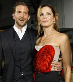 Bradley Cooper and Sandra Bullock pose at the premiere of All About Steve Wednesday.