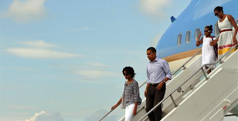 Ready for relaxation: President Obama and first lady Michelle Obama disembark from Air Force One with daughters Malia, 11, left, and Sasha, 8, for a family vacation on Martha's Vineyard, where the parents pleaded with the press corps to leave their daughters alone.