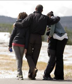 Touring the country: The Obamas visit Old Faithful at Yellowstone in Wyoming this month. &quot;He wants very much to see and share the outdoors and some of the beautiful places in the country with his daughters,&quot; spokesman Robert Gibbs said.