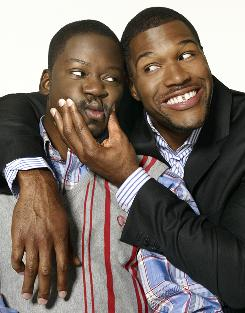 "Retired NFL player Michael Strahan, right, plays a retired NFL player in Fox series Brothers. Daryl ""Chill"" Mitchell stars as his brother."
