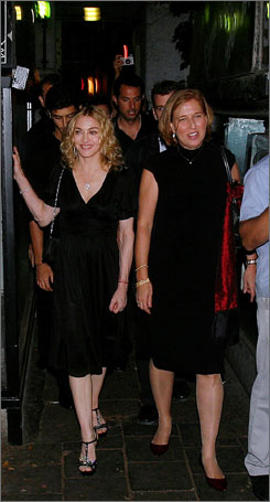 Madonna and Israeli Kadima party leader Tzipi Livni, right, leave a restaurant in Tel Aviv after having dinner there together Monday night.