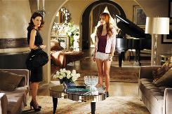 Laura Leighton, left, and Ashlee Simpson-Wentz settle into a refurbished and updated Melrose Place.