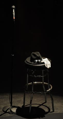 The King of Pop's trademark fedora, aviator sunglasses and sequined glove were on display at a late June memorial at New York's Apollo Theater.