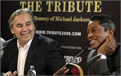 Tribute organizer Georg Kindel, left, joins family representative Jermaine Jackson to announce the lineup for the Sept. 26 concert for his brother. Chris Brown, who had been excluded from the Los Angeles memorial because of his legal problems, will perform in Vienna.