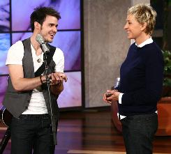 Have a little fun: Talk-show host Ellen DeGeneres, with American Idol Kris Allen, was named the fourth judge for the singing competition on Wednesday.