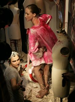 An artist of style: Zac Posen paints a one-of-a-kind gown on model Anna Cleveland in the window of Bergdorf Goodman for Fashion's Night Out.