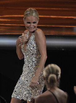 Her night to sparkle: Kristin Chenoweth, star of the canceled Pushing Daisies, takes the evening's first Emmy trophy: best supporting actress in a comedy.