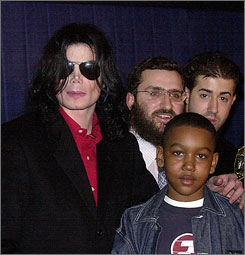 Rabbi Schmuley Boteach, center, has written a new book based on 30 hours of interviews with his late friend, Michael Jackson.