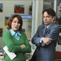 Making ends meet: The matriarch of a middle-class family in Indiana, Patricia Heaton works with Chris Kattan at a used-car dealer in The Middle.
