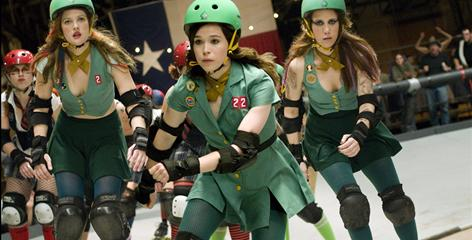 Drew Barrymore, left, Ellen Page and Kristen Wiig, in green faux Girl Scout uniforms, are members of the Hurl Scouts roller derby team in Whip It. 