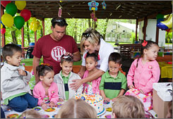 In happier times, Jon and Kate celebrate the sextuplets' fifth birthday party.