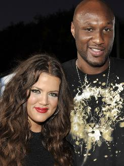 Actress Khloe Kardashian and NBA star Lamar Odom tie the net, er, knot.