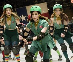 Smackdown on the track: Bliss (Ellen Page), center, finally fits in when she joins the Hurl Scouts roller derby team with Drew Barrymore, left, and Kristen Wiig.