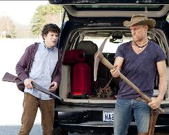Use whatever you can find: Jesse Eisenberg, left, and Woody Harrelson are on the hunt for the undead.