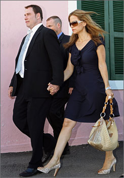 John Travolta and his wife, Kelly Preston, leave the court building in Nassau, Bahamas on Sept. 30.