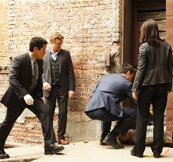 Sticking their noses in: Cho (Tim Kang), left, Jane (Simon Baker) and Rigsby (Owain Yeoman) conduct their own investigation when Lisbon (Robin Tunney, right) is accused of killing a child molester.