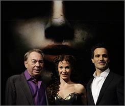 Andrew Lloyd Webber, left,  with stars Sierra Boggess, center, who will play Christine Daae,  and Ramin Karimloo, who will portray  the Phantom in Love Never Dies.