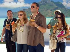 Fantasy Island, it's not: Jon Favreau, left, Malin Akerman, Vince Vaughn, Faizon Love and Kristin Davis arrive in Bora Bora.