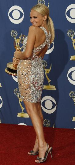 Showing some leg, and some back: Kristin Chenoweth with her Emmy.