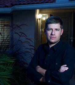 """Just a movie right? Director Oren Peli says the realistic setting, a couple's suburban house, makes Paranormal Activity even creepier. """"Some part of your brain may be saying, 'It's just a movie ... It's just a movie ... ,' but everything we show you seems real."""""""