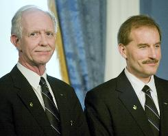 "Pilot Chesley Sullenberger, left, and First Officer Jeffrey Skiles of US Airways Flight 1549 attend a news conference Feb. 9 at New York's City Hall, where Mayor Michael Bloomberg presented the keys to the city to them. Sullenberger, with ""immense help"" from Skiles, executed an emergency landing on the Hudson River on Jan. 15, saving all the passengers on board."
