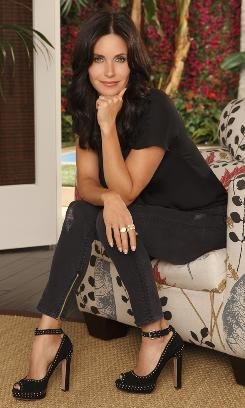 "Kittenish quality: Courteney Cox says she's as ""kooky"" as her character, Jules, on ABC's Cougar Town."