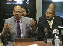 Tom Joyner, left, is joined by Harvard professor Henry Louis Gates during a hearing with the South Carolina Department of Pardon, Probation and Parole in Columbia on Wednesday.