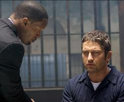 Anything for revenge: Clyde (Gerard Butler), right, goes on a killing spree after his wife and child's murderers don't get their due punishment in the case prosecuted by Nick (Jamie Foxx).