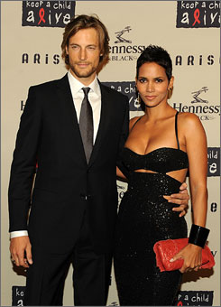 Arm in arm, model Gabriel Aubry and Halle Berry attend the Keep a Child Alive benefit in New York.