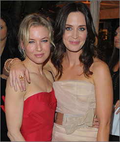 Renee Zellweger, left, and Emily Blunt mug for photos at the Elle soiree.
