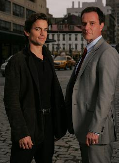 Partners in crime-solving: Matt Bomer, left, plays con man Neal Caffrey and Tim DeKay portrays FBI agent Peter Burke in USA Network's new series White Collar. It premieres Friday at 10 p.m. ET/PT.